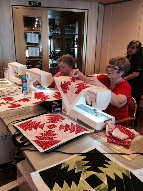 Carolyn and Carol Marchant sewing pineapples in Anita Grossman Solomon's class.